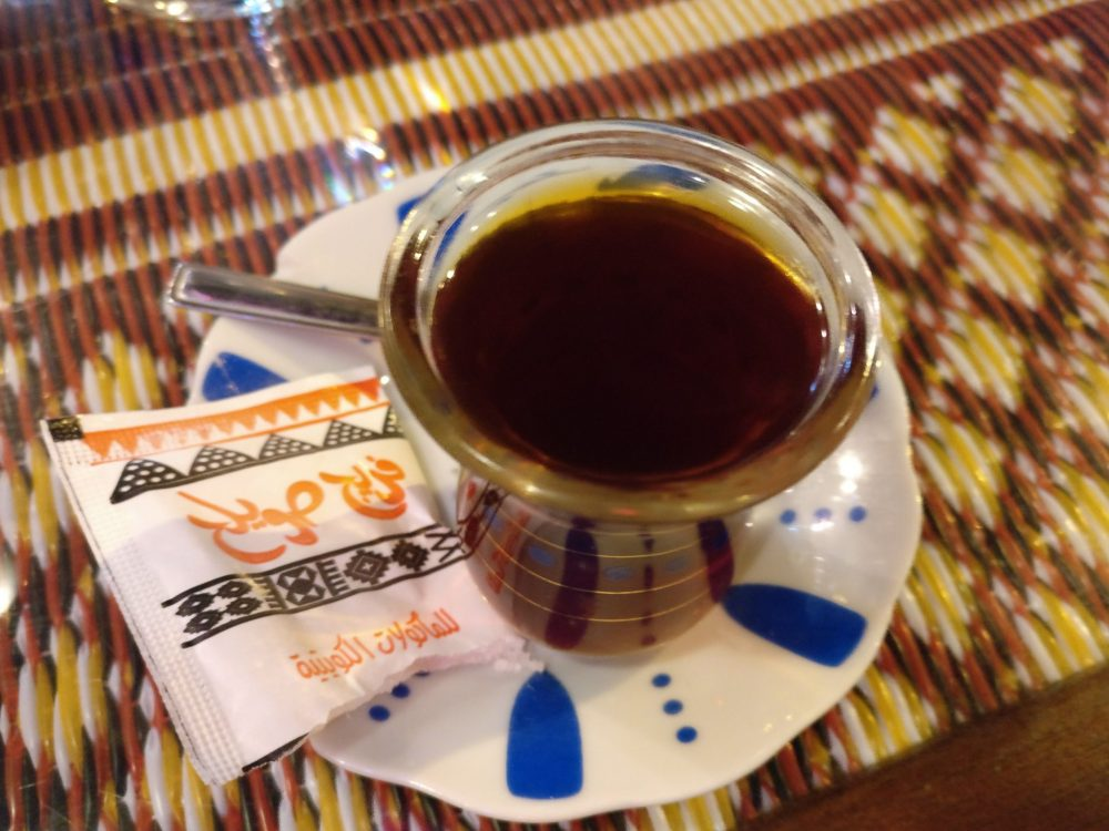a very small glass of very strong tea in Kuwait City Souk