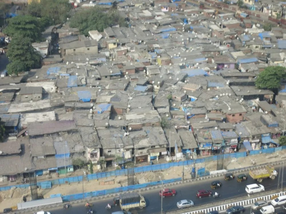 I apologize for the graininess of this photo: my compact camera can't zoom very well. I took this from the 18th floor of my hotel. The slum you see is not Dharavi, but rather one of the 2000 or so other slums in Mumbai. This picture gives you an idea of how narrow the houses are. Dharavi slum tour