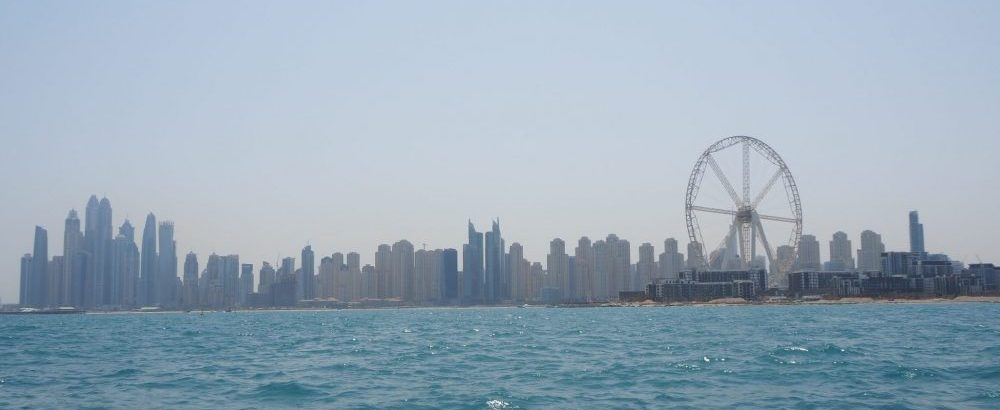 The Dubai skyline as seen from the water, on a typically hazy day.