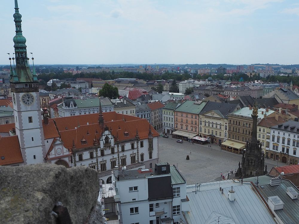 A view of Upper Square in Olomouc as seen from St. Maurice church tower. You can see the UNESCO site Holy Trinity Column on the right and the town hall spire on the left.