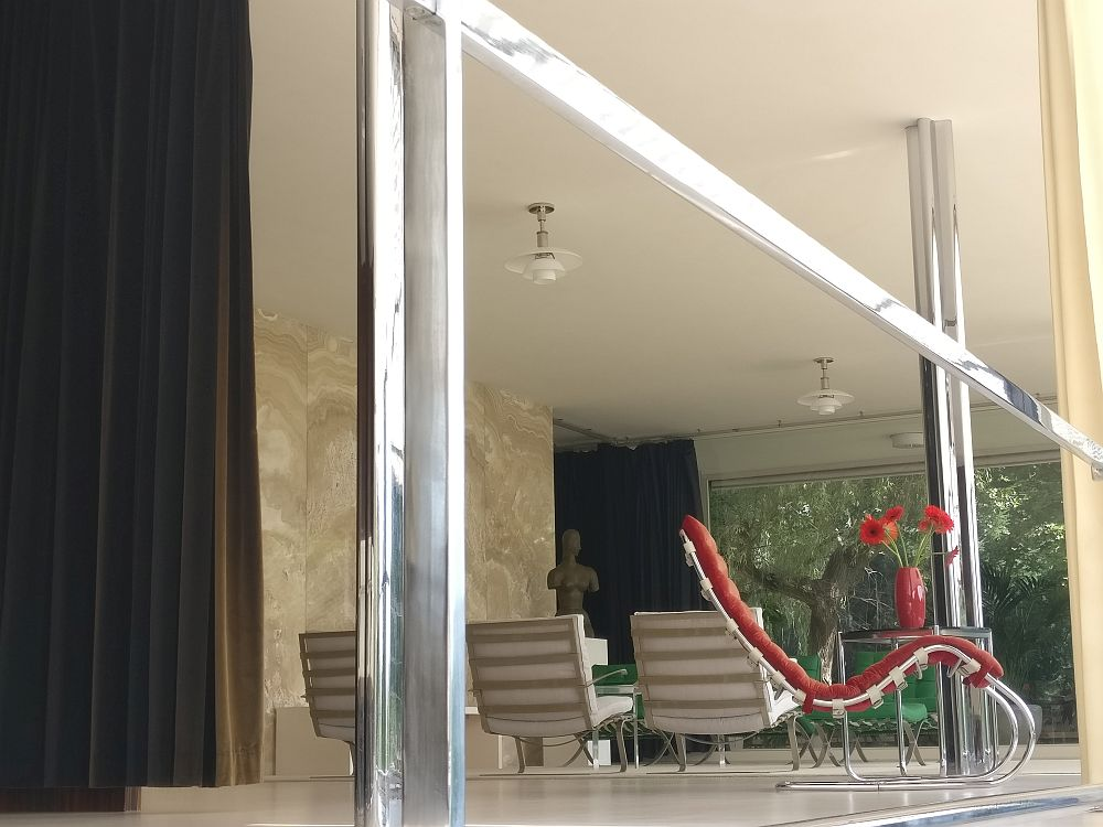 Mies van der Rohe also designed the furniture of Villa Tugendhat. In this shot, taken from outside looking in, you can see some classic pieces.
