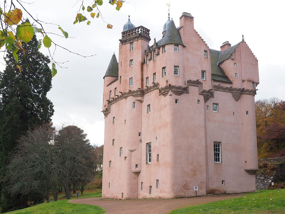 Craigievar Castle in Aberdeenshire is tall and pastel pink.