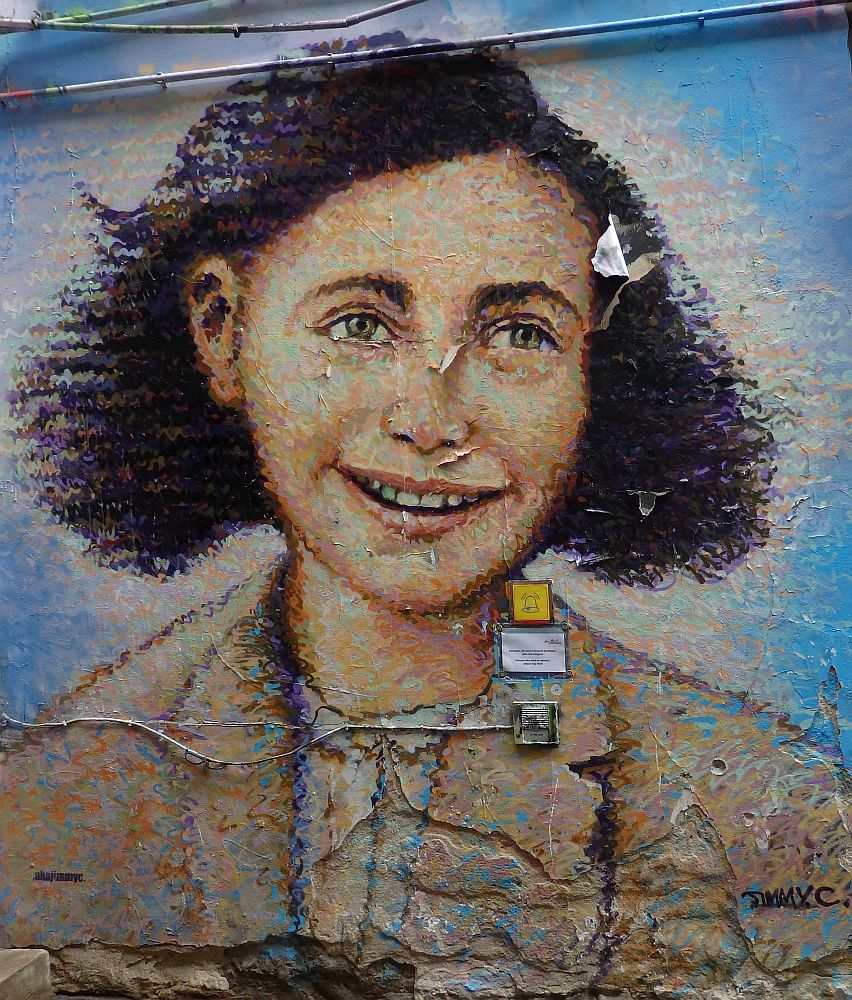 A smiling portrait of Anne Frank.