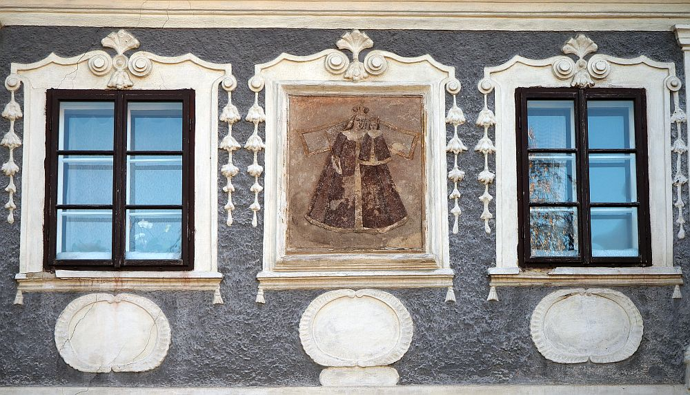 a painted detail on a stuccoed building