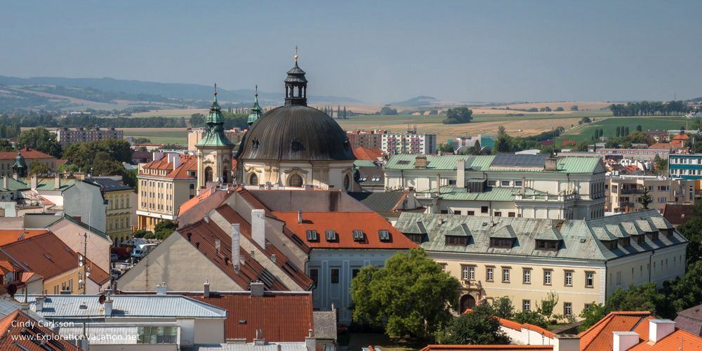 A jumble of buildings, with a domed cupola in the middle distance