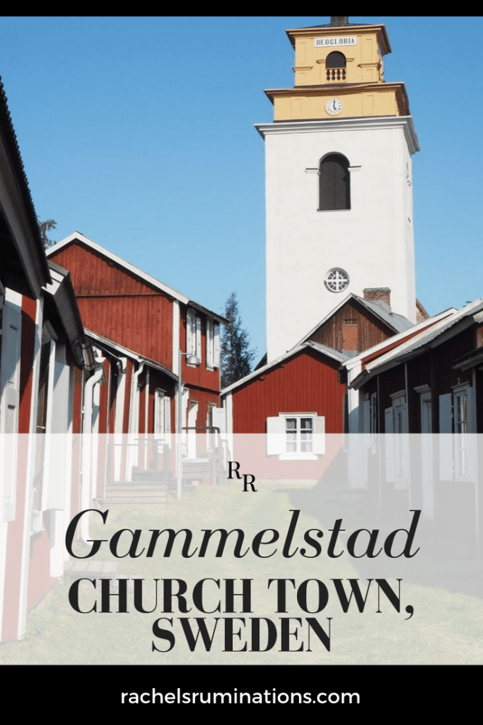 Pinnable image Image: small red houses on either side, with a tall white church tower in the background. Text: Gammelstad church town