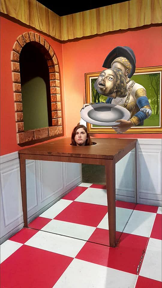 """Another photo from the Trick Eye Museum in Hongik University Street. Jessica Esa's head is on a table, as if it's been chopped off and set there. It looks (almost but not quite completely) like the floor continues under the table, but in this photo the """"trick eye"""" is visible because the image of the floor doesn't quite line up. It looks as if the portrait above her on the wall is hoding a plate out of the portrait over her head, with a severed head either dropping into the plate or being dropped - it's not quite clear."""
