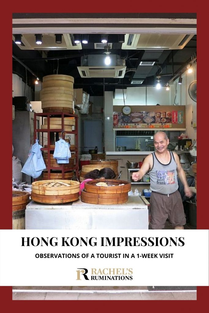 Text: Hong Kong Impressions: Observations of a tourist in a 1-week visit (and the Rachel's Ruminations logo) Image: a man smiles as he points at a basket full of dim sum in the storefront shop he runs. The view shows the whole interior of the kitchen where he prepares the dim sum.