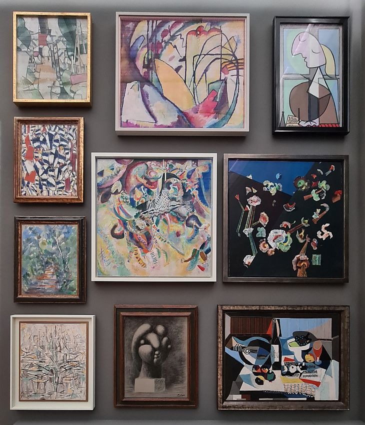 The paintings are all abstract except for the Picassos, where it's possible to discern a bit of what is represented.