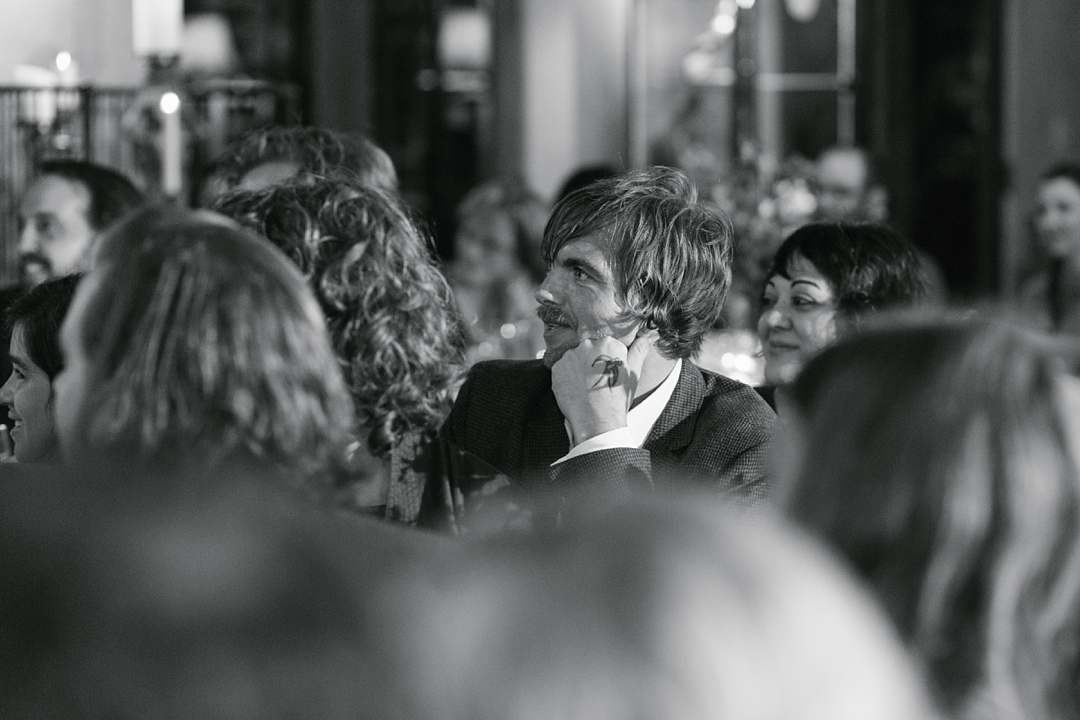 black and white of guest listening to speech