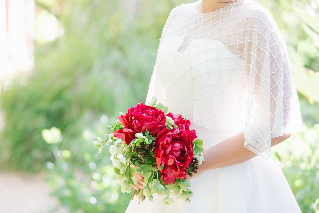 detail of red bridal bouquet