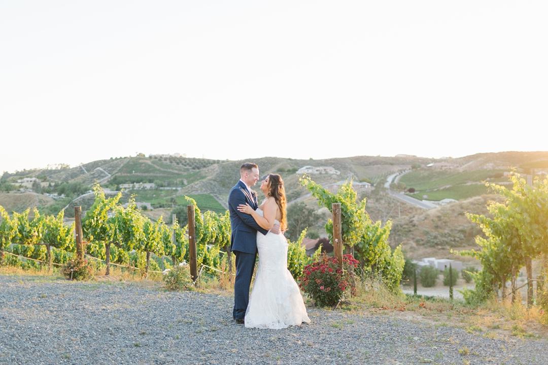 horizontal photo of couple in temecula vineyard