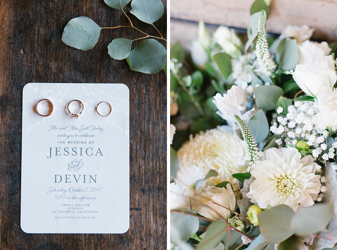 letter pressed wedding invitation next to eucalyptus floral bouquet