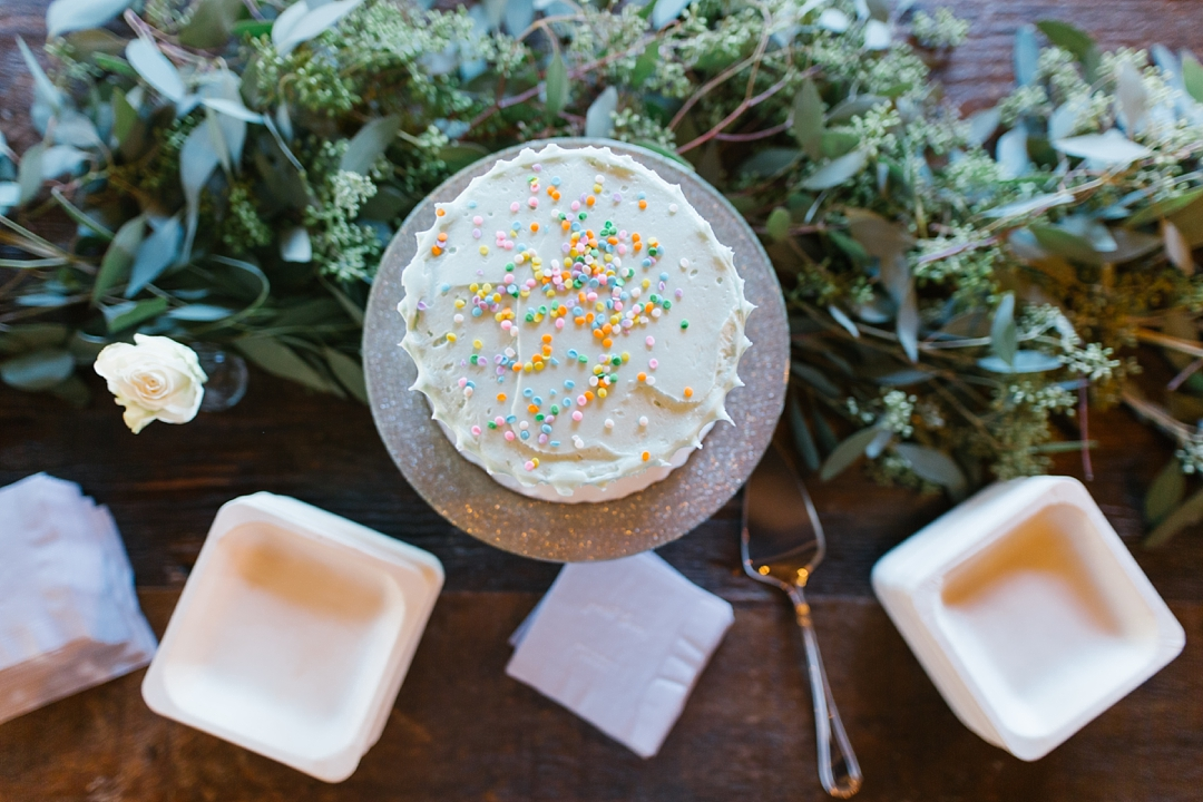 aerial view of blue wedding cake with colorful sprinkles