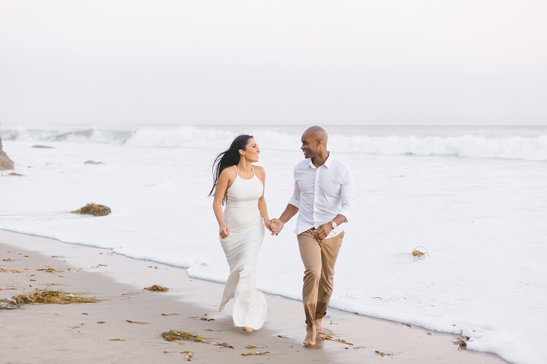 malibu engagement couple running on beach