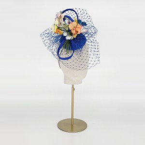 Royal blue pillbox with pansies and veiling