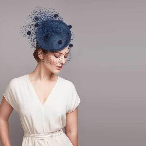 Blue fine straw disc with pom pom veil