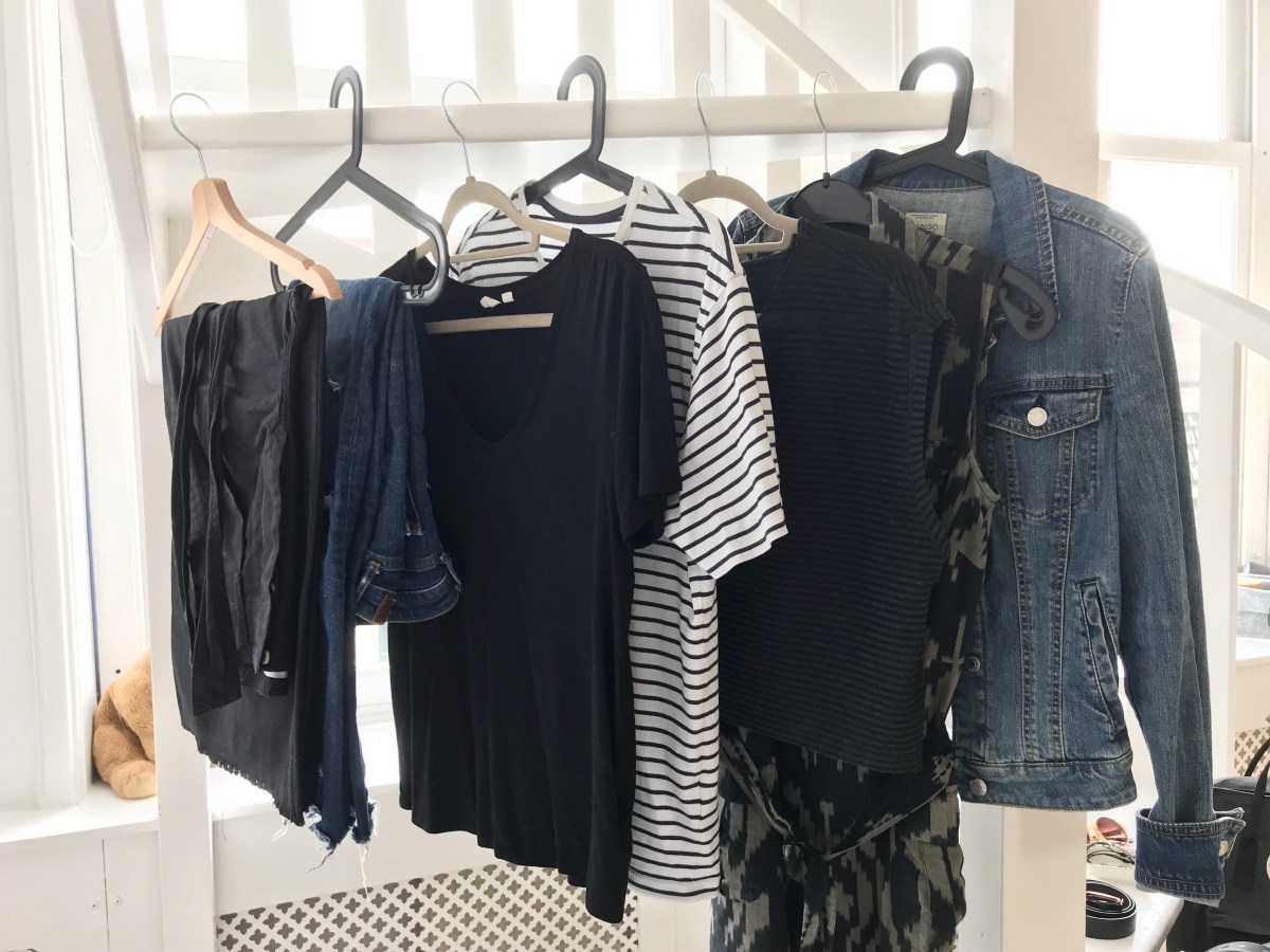 wardrobe challenge clothing pictured: black culottes, ripped jeans, black t-shirt, black and white stripped t-shirt, black and grey top, patterned sleeveless shirt dress, jean jacket