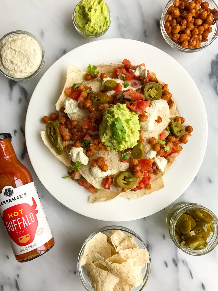 Vegan Buffalo Chickpea Nachos with Queso Sauce for a delicious plant-based nacho treat!