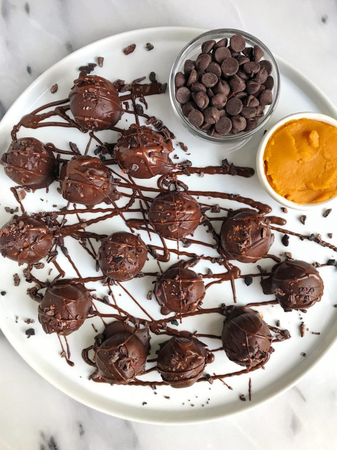 Simple + Easy Paleo Fudgy Pumpkin Pie Truffles made with just 7 ingredients!