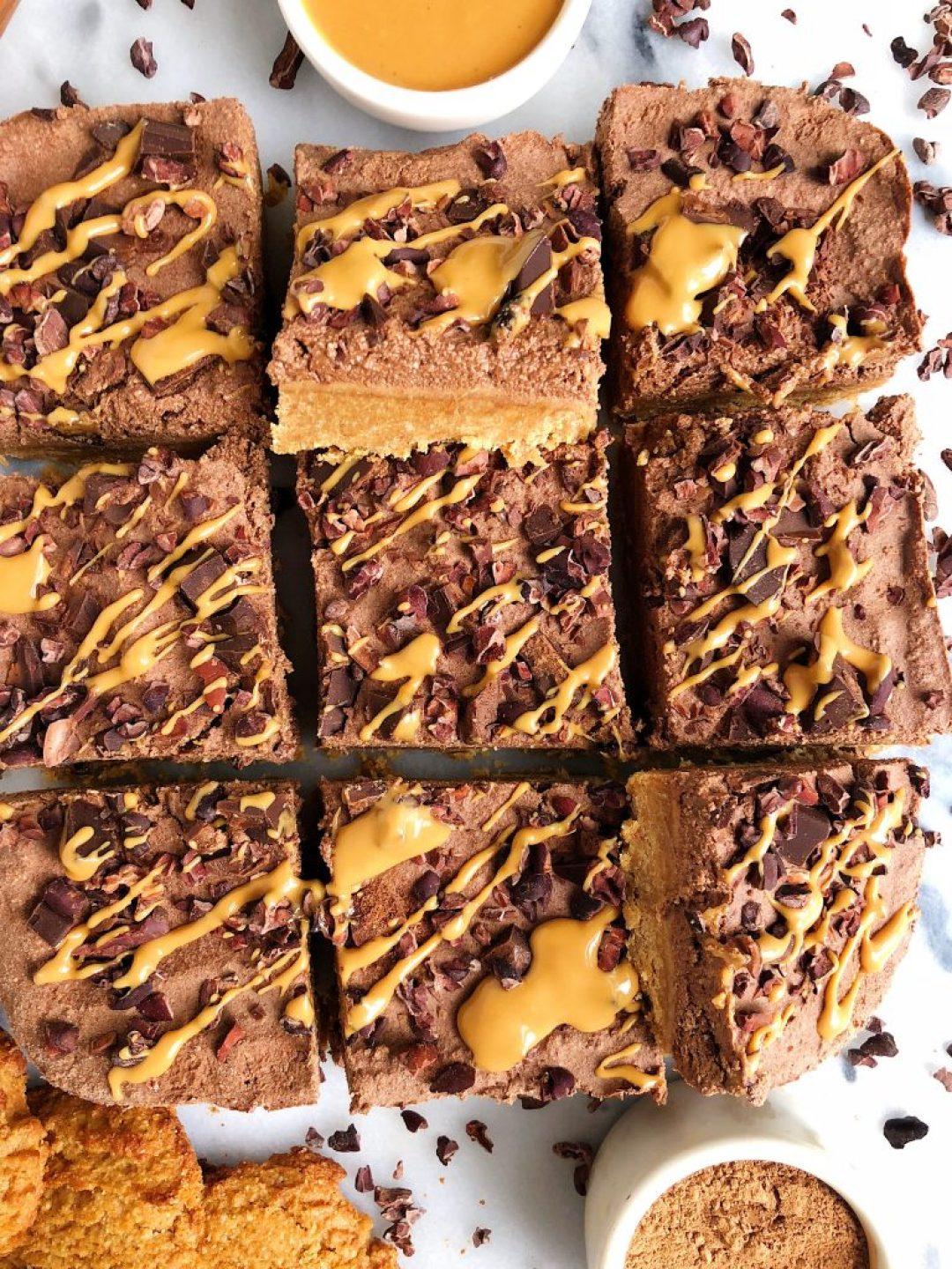 Dark Chocolate Peanut Butter Pie Bars made with a cookie crust and topped with a cashew-less chocolate pie filling sweetened with maple syrup!
