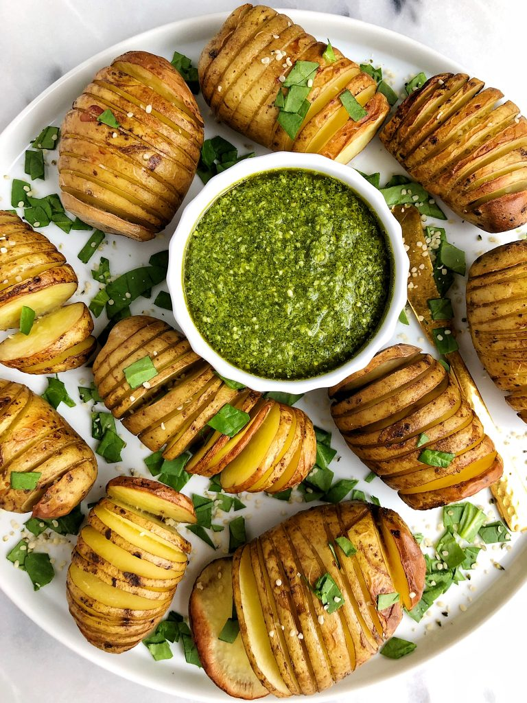 Sharing these Whole30 Hasselback Potatoes with Garlicky Basil Pesto. Extra crispy potatoes paired with the dreamiest dairy-free pesto. A delicious vegan Whole30recipe!