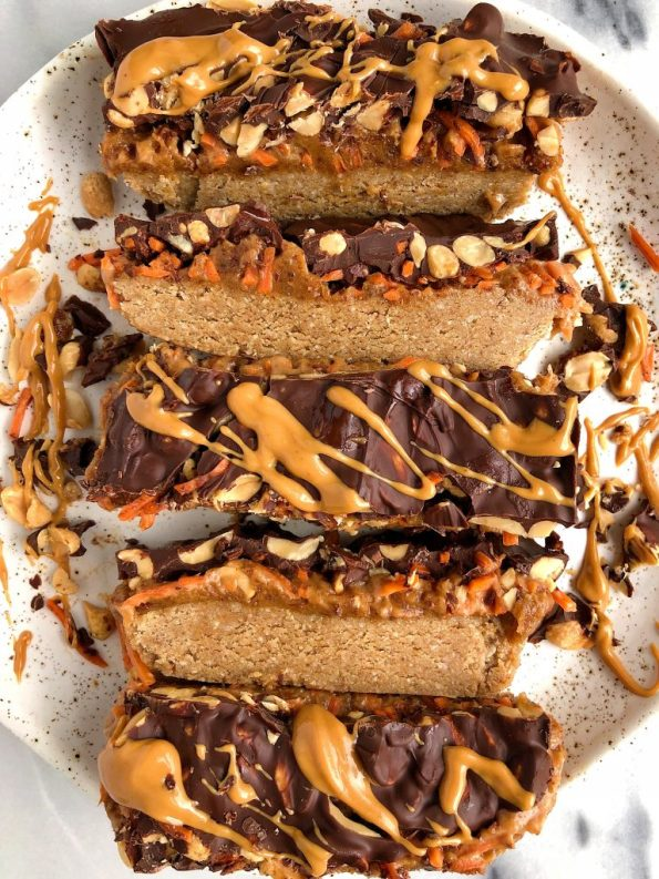Raw Carrot Cake Candy Bars made with gluten-free and dairy-free ingredients for a healthier candy bar recipe with a peanut butter caramel and oatmeal cookie layer!