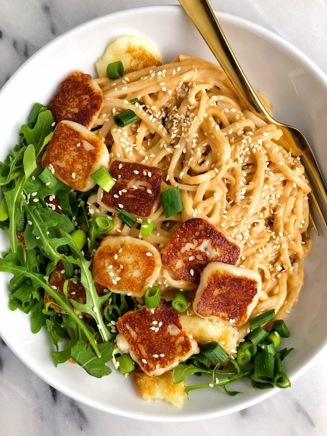 Easy Sesame Peanut Tahini Noodles with Halloumi for an healthier spin on a takeout noodle bowl! Made with all gluten-free ingredients.