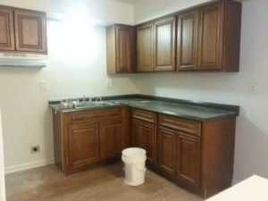 The new cabinets are being installed in the apartments on Jacato Drive.