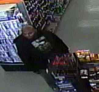 Racine police believe the man in this photo robbed three different locations Friday around the city.