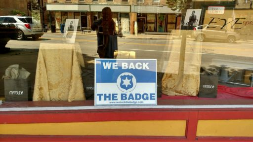 Retailers show support for police with Back the Badge signs. (photo by Ken Brown)