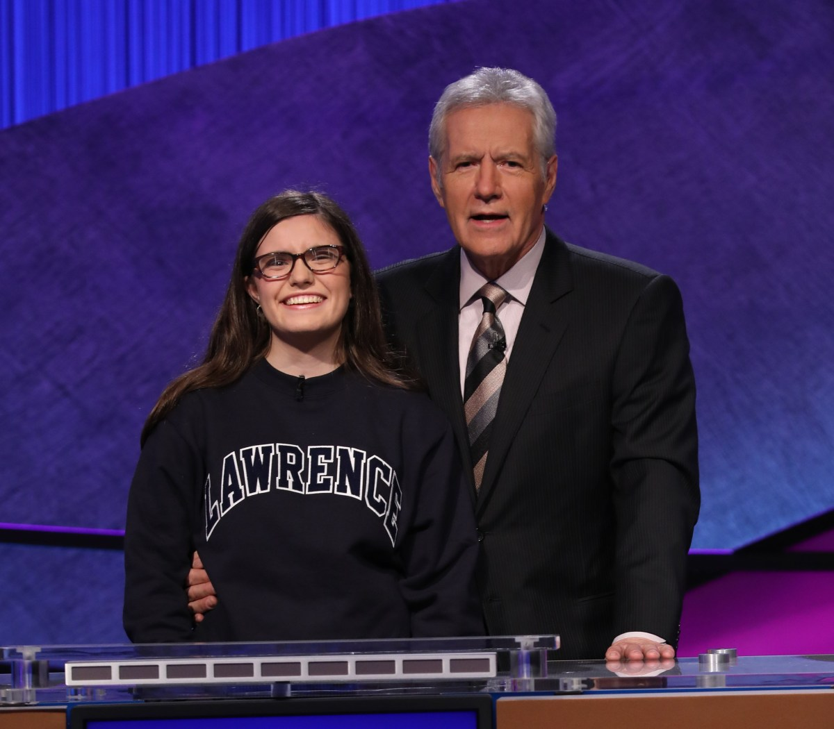 Allison Holley, formerly of Racine, poses with the host of JEOPARDY, Alex Trebeck.