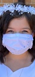 Flower girl wearing mask