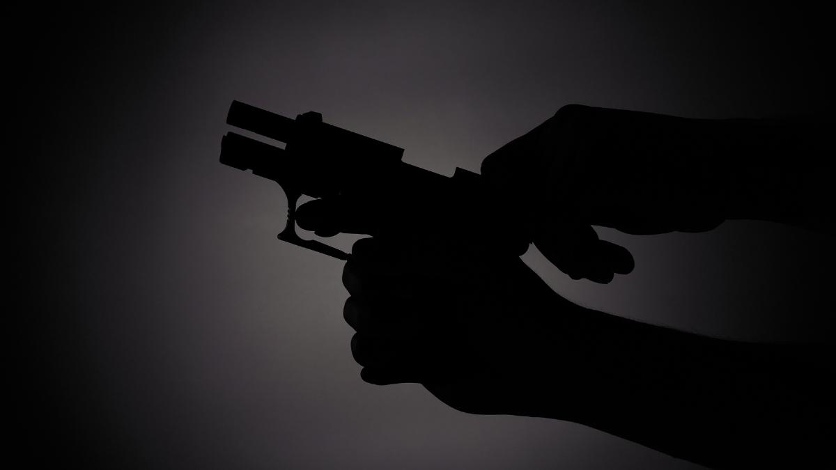 displaying gun, Caledonia, Wisconsin