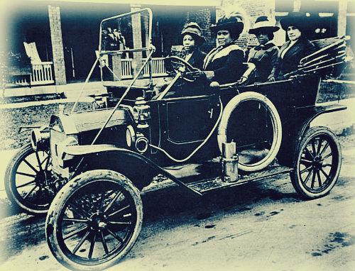 Madame Walker driving her friends