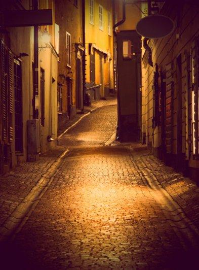 Cobblestone Alley At Night.