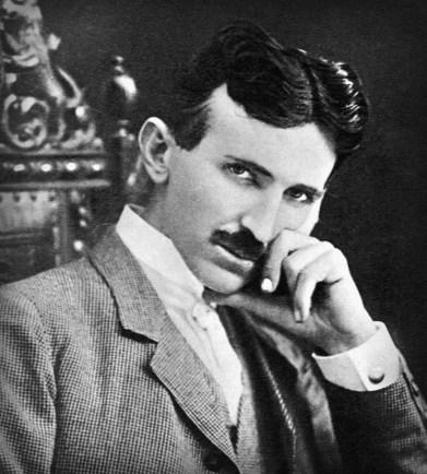 Bust image of Nikola Tesla with hand at chin.