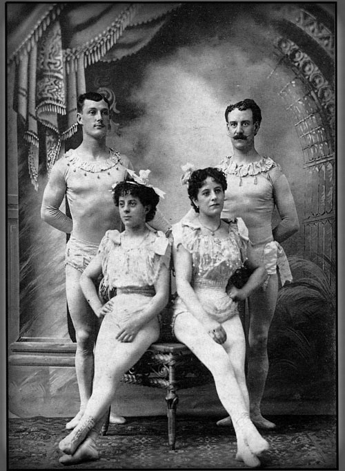 Flying Zedoras black and white photos with two men standing and two women sitting in circus leotards inc. 1890s.. Image: flyingzedoras.org.uk.