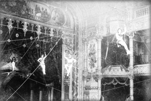 four Flying Zedoras c. 1890s.. pose on high wires near the ceiling of a performance hall Image: Victoria and Albert Museum.
