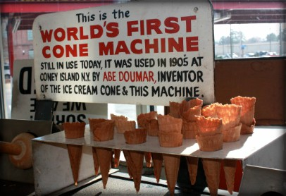Sign reads Doumar's First Cone Machine above several ice cream cones.. Image: Doumars.com.