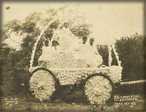 1913 Juneteenth Carriage decorated with flowers with Group of five or six African American women sitting in a carriage.