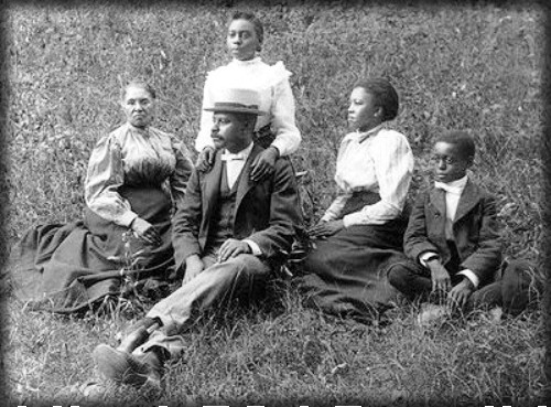 Family Picnic c. 1910-1925. Photograph by John Johnson, from the Douglas Keister Collection.