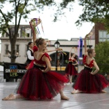 grand-center-st-louis-dancing-in-the-streets-girls-in-red-costumes