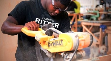 Young man uses power tools