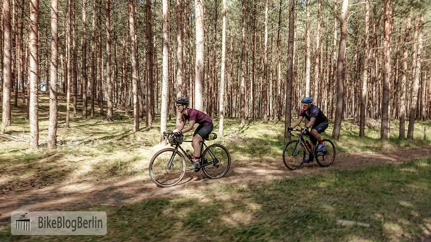 two cyclists in the woods