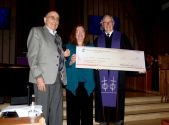 (L to R) NRV Habitat board member Don Mullins, Humanity NRV Executive Director Shelly Fortier and BUMC Pastor Ralph Rowley show off a larger-than-life check symbolizing the church's donation.