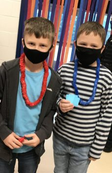 4. Third grade brothers Camerson and Bryce Harvey show their house colors.