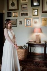 Nervous bride waiting in lounge of Askham Hall