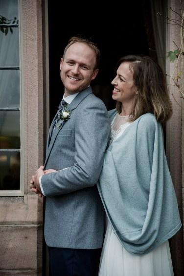 Bride and Groom in romantic pose at Askham Hall, Cumbria