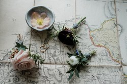 Map, ring and button hole details from winter inspired shoot at Askham Hall